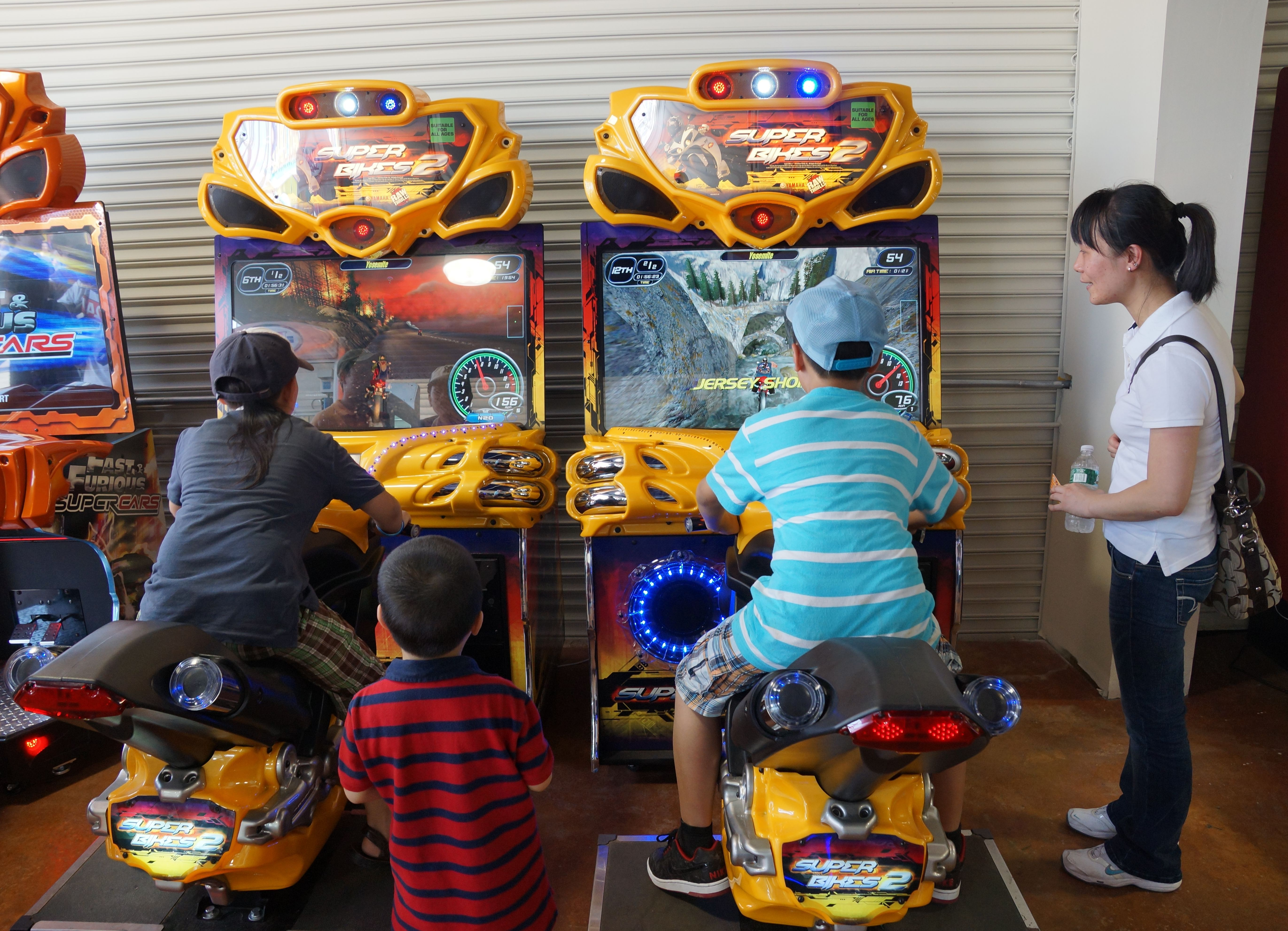 Arcade clipart ride. The motorcycles at brand