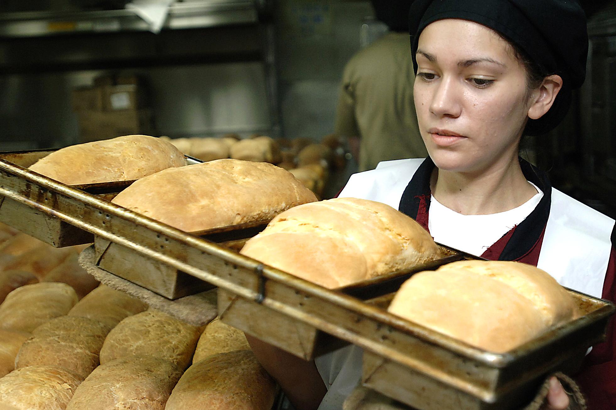 Baker clipart baking bread. Free public domain image