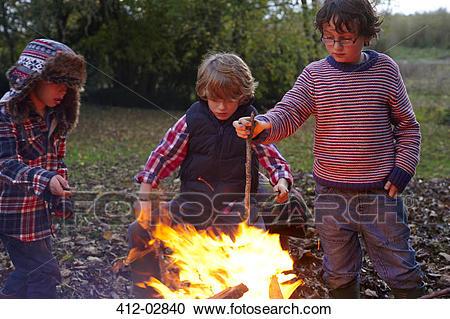 Boy roasting marshmallow free. Bonfire clipart kid