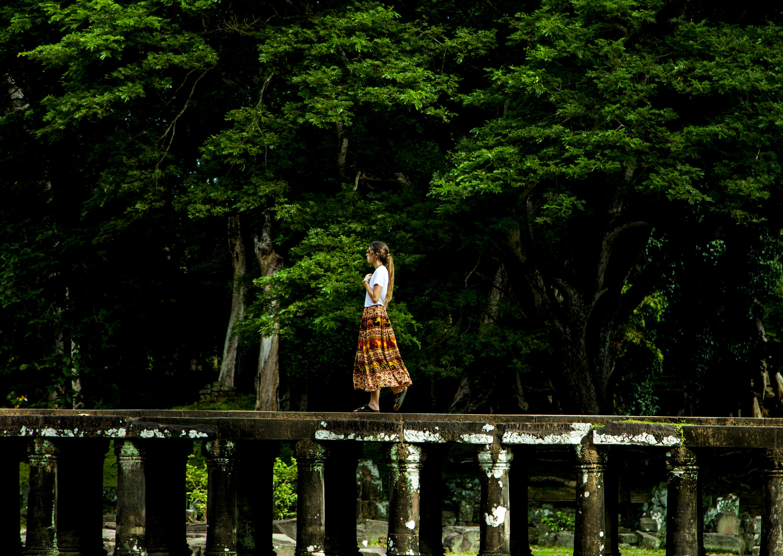 Woman walking on image. Bridge clipart forest