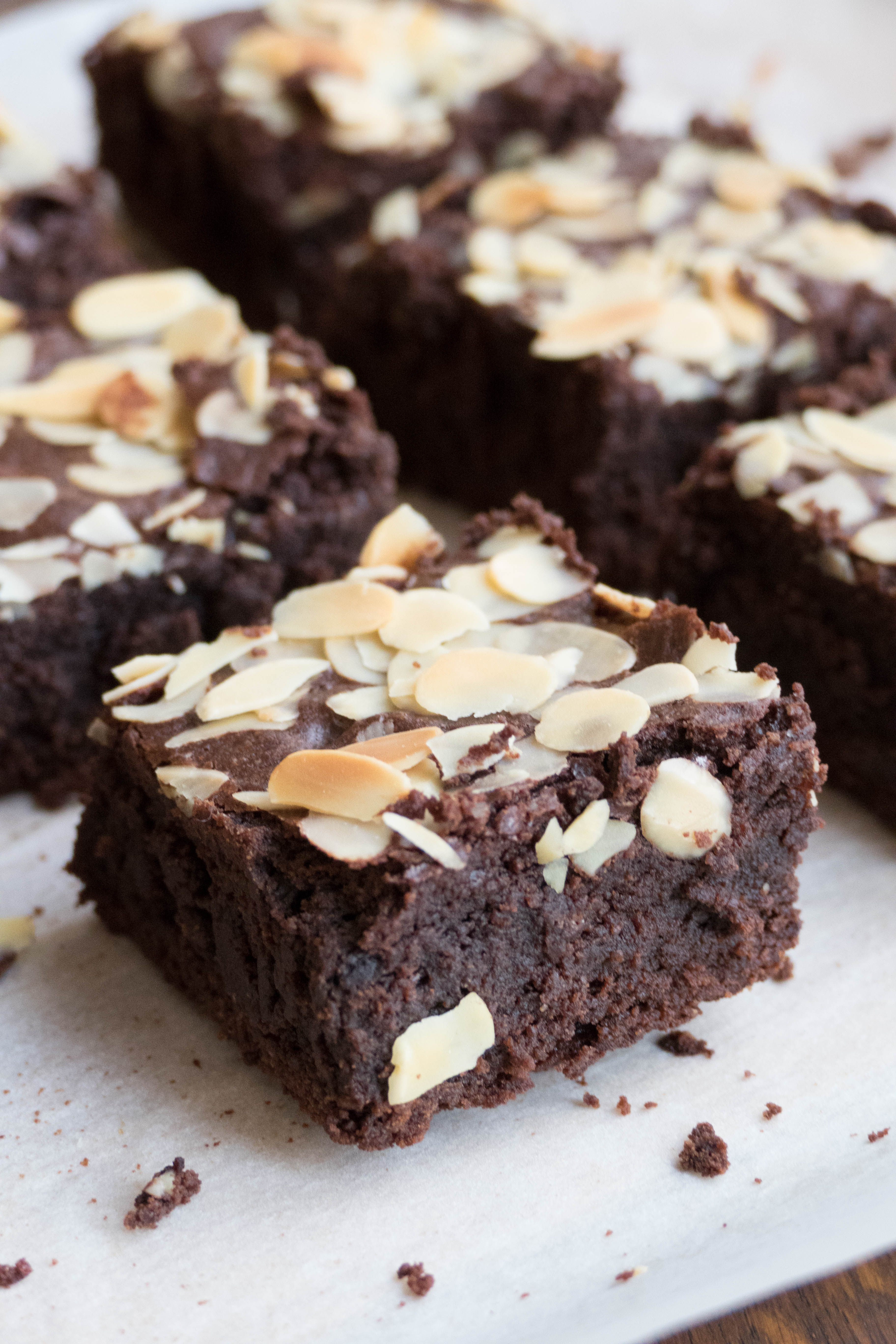 Dark with almond slices. Brownie clipart chocolate slice