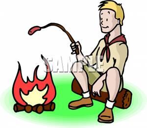 A boy scout roasting. Campfire clipart hotdog