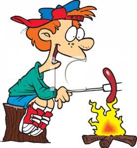 Campfire clipart hotdog. A young boy cooking