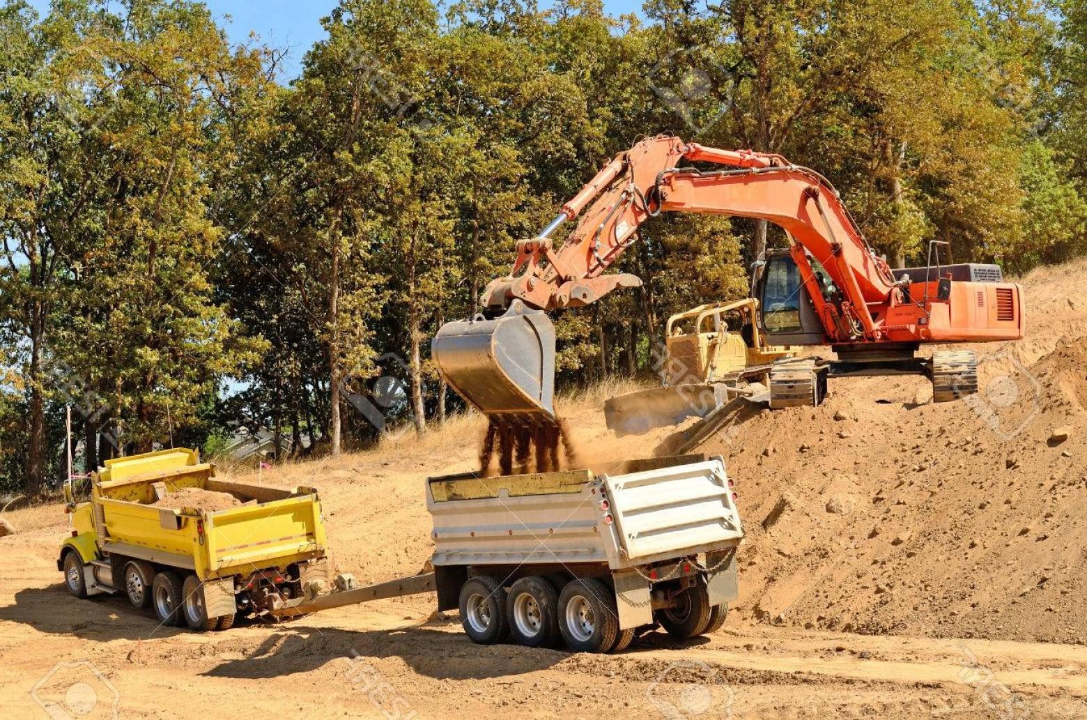 Photolarge track hoe filling. Excavator clipart rock quarry