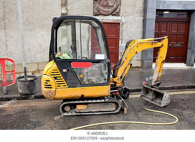 Excavator clipart rock quarry. Backhoe stock photos and