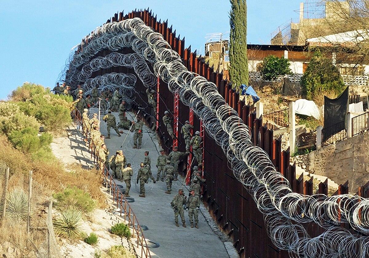 Fence clipart border wall. Arizona city officials want