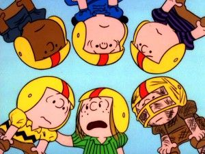 Peanuts clipart football. In a team huddle
