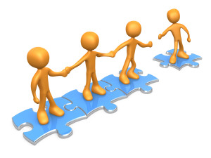 Teamwork clipart puzzle piece. Team of three orange